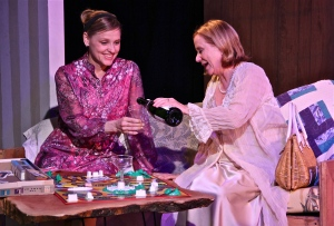 Anika Larsen and Eve Plumb as niece and aunt sharing a glass of prosecco